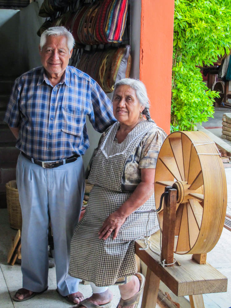 Paco's parents next to a traditional loom.