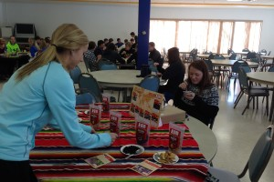 Students taste-test Fair Trade nuts and dried fruit during lunch in the Loyola Cafe.