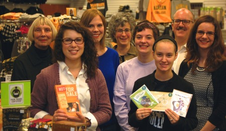 Our wonderful Fair Trade Committee with the cholocate, cards, and Not For Sale book that is now sold in the bookstore!