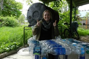 SSI Water Coordinator Andrea Carson tries out the chair she and SSI Intern Rich Manuli made.