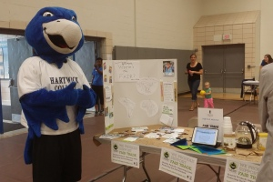 Our mascot, Swoop, takes a moment to approve of Fair Trade Hartwick at our True Blue Weekend 2014 Carnival.