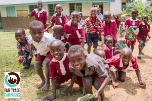 (The Busamaga primary society within Gumutindo voted to use some of their Fair Trade community development funds to repair the roofs of the local school's buildings after they were taken off by a big storm. Previously children had to sit on the ground, which made learning handwriting very difficult.)