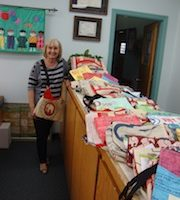 Principal displays many of the fair trade bags purchased by parents.